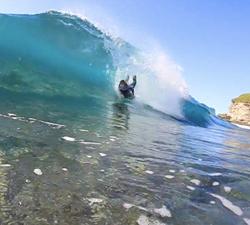 Bodyboarding shallow reef